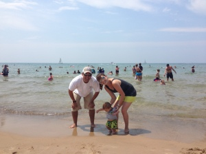 How I Spent My 4th of July: With the Gerstner Family on Lake Michigan.  Lucas was clearly too interested in the sand to look at the camera, but we'll work on it