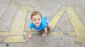 Looks like my adorable sidekick is enjoying the University of Michigan as much as his daddy does