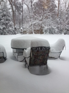 By 2pm, the snow is already to the seat on the chair and above my knee past the patio set